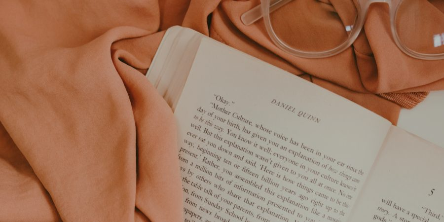 Photo of peach book and glasses by vanessa serpas